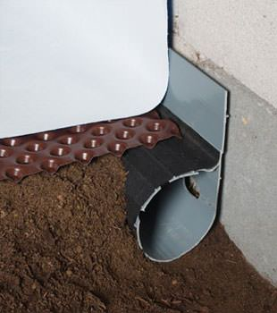 Closeup of a crawl space drainage system installed in Sunderland