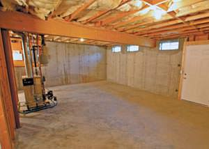 a very large, empty section of a basement.