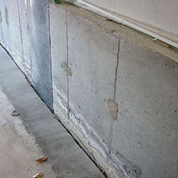 A weeping tile system that incorporates an open gap along the floor that will accept dirt, dust, and debris.