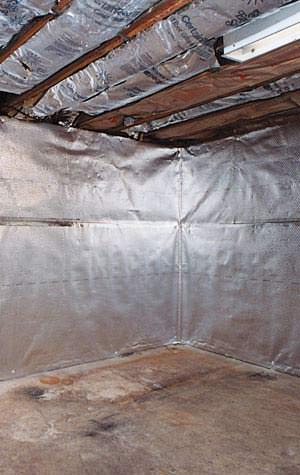 vapor barrier and radiant heat barrier installed on a basement wall