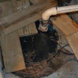 A clogged sump pump system filled with mud.