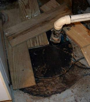 a sump pump that's been clogged with mud in the liner.