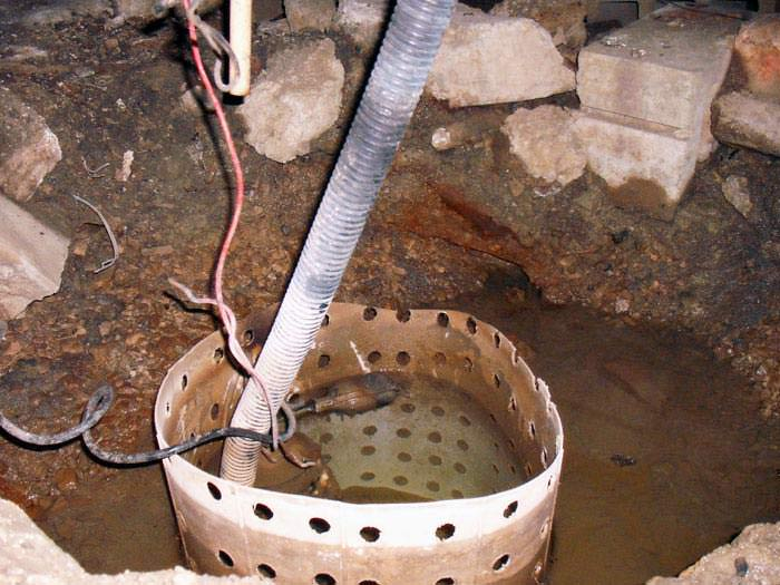 A Sump Pump With An Old Fashioned Float Switch Installed In A Sump Pit.
