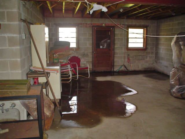water is flooding into this basement through the basement wall floor