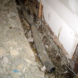 A do it yourself basement drain system installation in progress