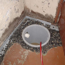 Installing a sump in a sump pump liner in a Manchester home