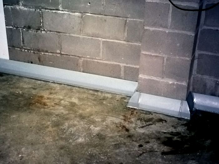 Baseboard Basement Drain Pipe System In Greater London