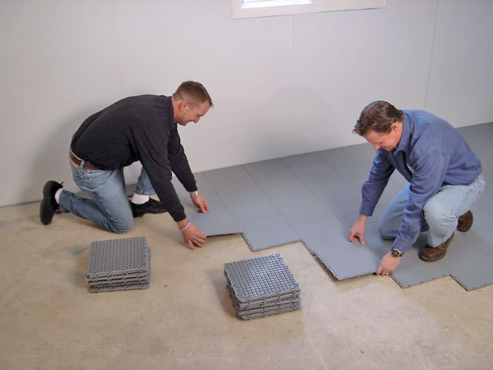 basement sub floor tiles and matting on a concrete basement floor